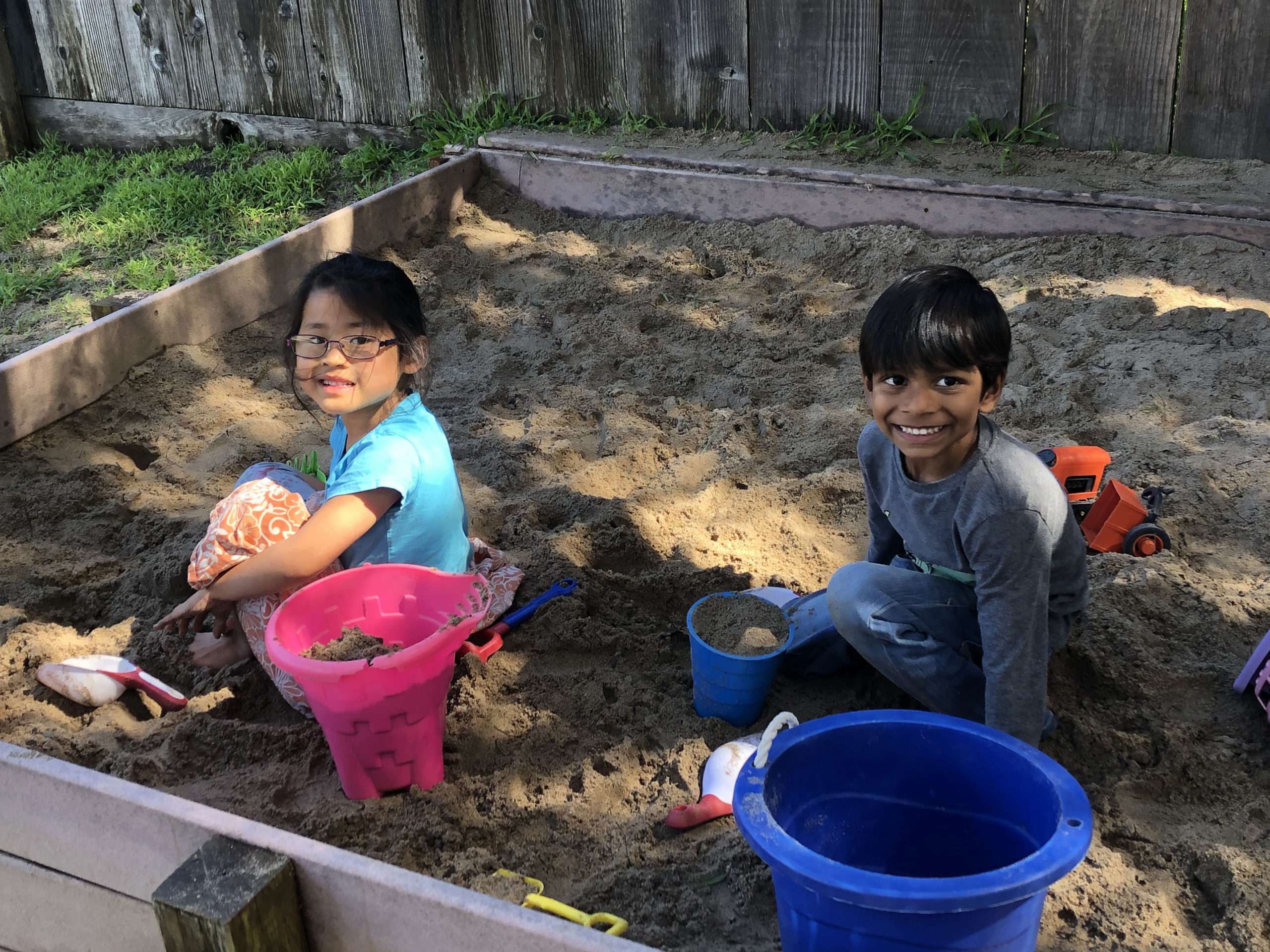 Friends - two friends playing in the sand box